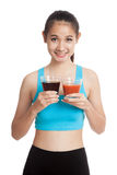 Beautiful healthy Asian girl with tomato juice and cola drinks Stock Photo