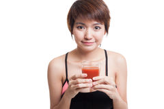 Beautiful healthy Asian girl with tomato juice. stock photo
