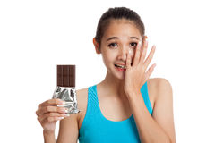 Beautiful  healthy Asian girl veary happy with chocolate Stock Image