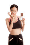 Beautiful  healthy Asian girl veary happy with chocolate Royalty Free Stock Photos