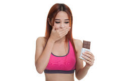 Beautiful  healthy Asian girl veary happy with chocolate. Stock Photo