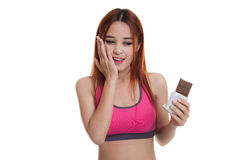 Beautiful  healthy Asian girl very happy with chocolate. Royalty Free Stock Images