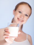 Beautiful healthy girl with a glass of milk Royalty Free Stock Image