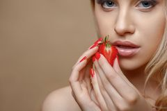 Beautiful healthy girl with red sweet fruit Stock Images
