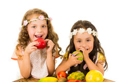 Beautiful healthy little girls eating delicious Royalty Free Stock Photo