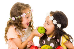 Beautiful healthy little girls eating delicious Stock Photography