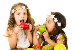 Beautiful healthy little girls eating delicious Stock Photos
