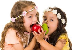 Beautiful healthy little girls eating delicious Royalty Free Stock Images