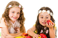 Beautiful healthy little girls holding delicious Royalty Free Stock Photo