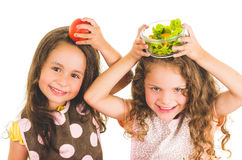 Beautiful healthy little girls holding fruits and Stock Photo