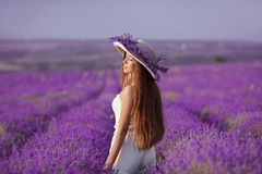 Beautiful healthy long hair. Back view of Young teen girl in hat royalty free stock image