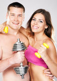 Beautiful healthy-looking couple in sports outfit Stock Images