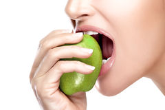 Beautiful Healthy Mouth Biting a Big Green Apple Stock Images