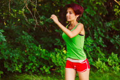 Beautiful healthy runs young brunette woman a Royalty Free Stock Photography