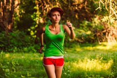 Beautiful healthy runs young brunette woman Stock Photos
