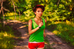 Beautiful healthy runs young brunette woman stock image