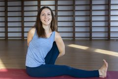 Beautiful healthy woman does yoga exercises in the gym, close up stock photos