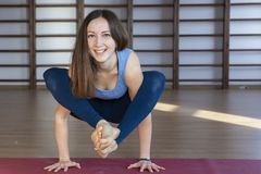 Beautiful healthy woman does yoga exercises in the gym, close up royalty free stock photo