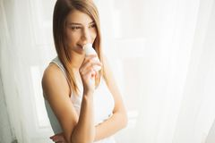 Diet. Beautiful Healthy Woman Drinking Natural Yogurt, Dairy Product. Beautiful Healthy Woman Drinking Natural Yogurt, Dairy Product stock photo