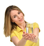 Beautiful healthy woman with drinking water glass in yellow polo Stock Photography