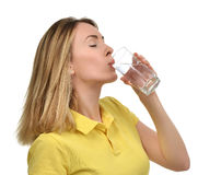 Beautiful healthy woman with drinking water glass in yellow polo Royalty Free Stock Photos