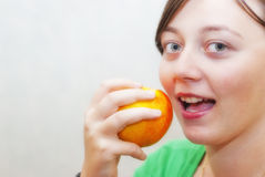 Beautiful healthy woman eats an apple. Health concept portrait with copy space Royalty Free Stock Images