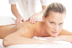 A beautiful and healthy woman getting alternative massage Stock Image