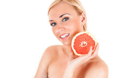 Beautiful healthy woman with half a grapefruit Stock Photography