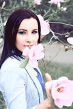 Beautiful Healthy Woman with magnolia flower Royalty Free Stock Image