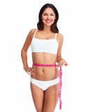 Beautiful healthy woman with a measuring tape. Stock Images