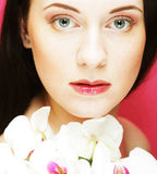 Beautiful healthy woman with orchid flower. Stock Photography