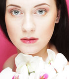 Beautiful healthy woman with orchid flower. Royalty Free Stock Images