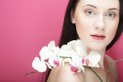 Beautiful healthy woman with orchid flower. Royalty Free Stock Image