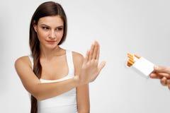 Beautiful Healthy Woman Quitting Smoking, Refusing Cigarettes. Royalty Free Stock Image