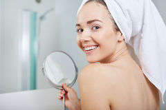Beautiful healthy woman and reflection in the mirror. Face of young beautiful healthy woman and reflection in the mirror Royalty Free Stock Image