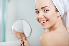 Beautiful healthy woman and reflection in the mirror Stock Photos