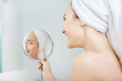 Beautiful healthy woman and reflection in the mirror Stock Images