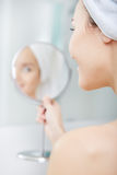 Beautiful healthy woman and reflection in the mirror Royalty Free Stock Images