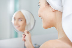 Beautiful healthy woman and reflection in the mirror Royalty Free Stock Photos