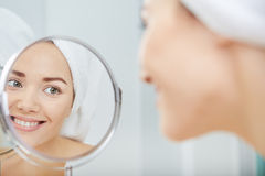 Beautiful healthy woman and reflection in the mirror Royalty Free Stock Image