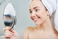 Beautiful healthy woman and reflection in the mirror Royalty Free Stock Photography