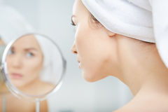 Beautiful healthy woman and reflection in the mirror Stock Image