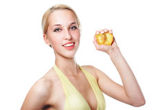 Beautiful healthy woman squeezes out juice of a pe. Ach isolated on white royalty free stock photo