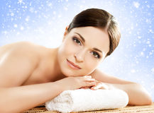 Beautiful and healthy woman in a winter spa salon Royalty Free Stock Images