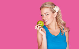 Beautiful healthy young woman with an apple Royalty Free Stock Photo
