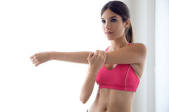 Beautiful healthy young woman doing exercise at home. Royalty Free Stock Photography