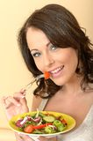 Beautiful Healthy Young Woman Eating a Fresh Garden Salad Stock Photography