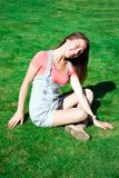 Beautiful healthy Young Woman sitting on grass Stock Photos