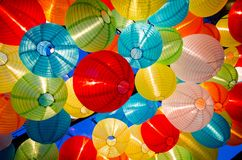 A heap of Colorful round paper lantern hanging on a ceiling. A beautiful heap of Colorful round paper lantern hanging on a ceiling royalty free stock photo