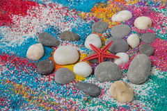 Beautiful heart background on colored sand made from sea shells Royalty Free Stock Photo